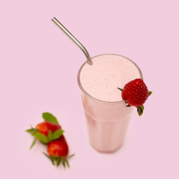 Strawberry Protein Beverage in glass with straw