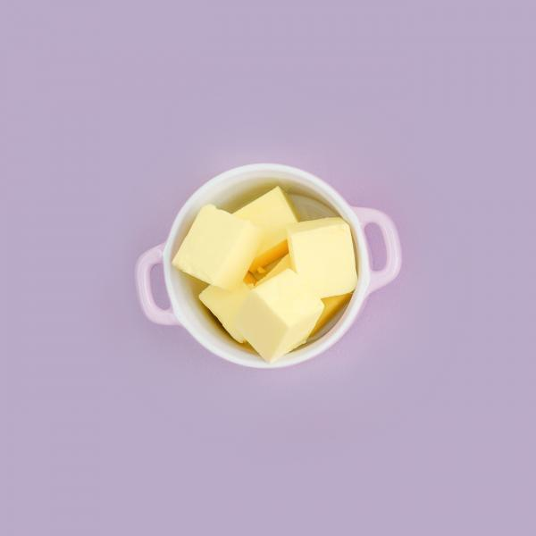 glanbia ireland ingredients butter in bowl on purple background